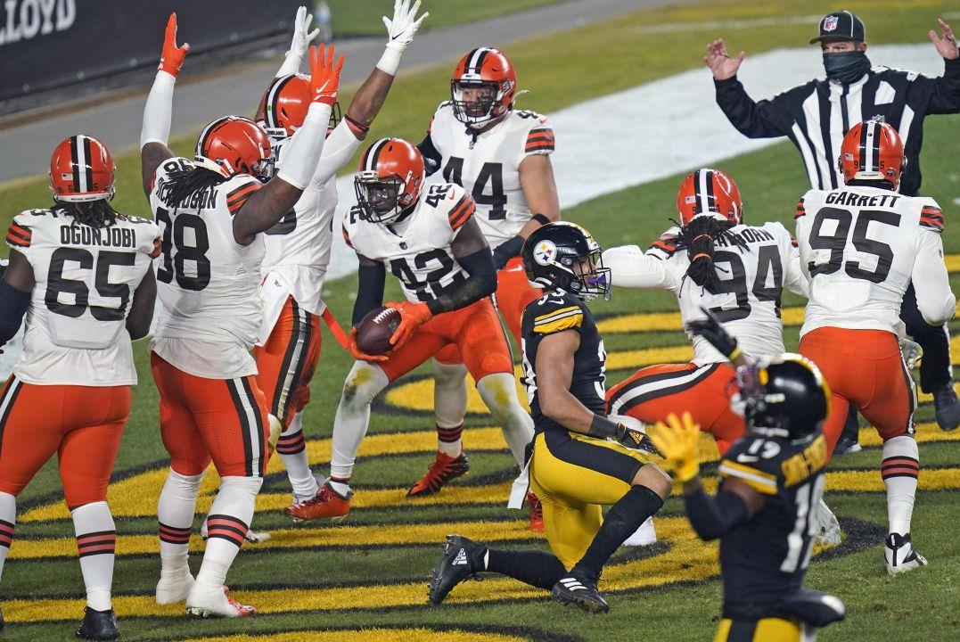 Cleveland Browns strong safety Karl Joseph (42) celebrates after recovering  a fumble in the during the first half of an NFL wild-card playoff football  game against the Pittsburgh Steelers, Sunday, Jan. 10,